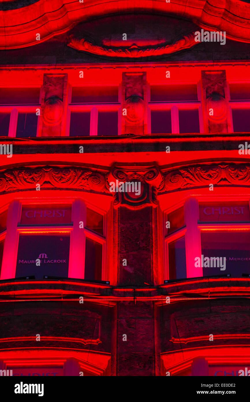 Farbig beleuchtetes Haus in der Münchner Neuhauser Strasse, Einkaufsstrasse, Colored lighted house in Munich - Stock Image