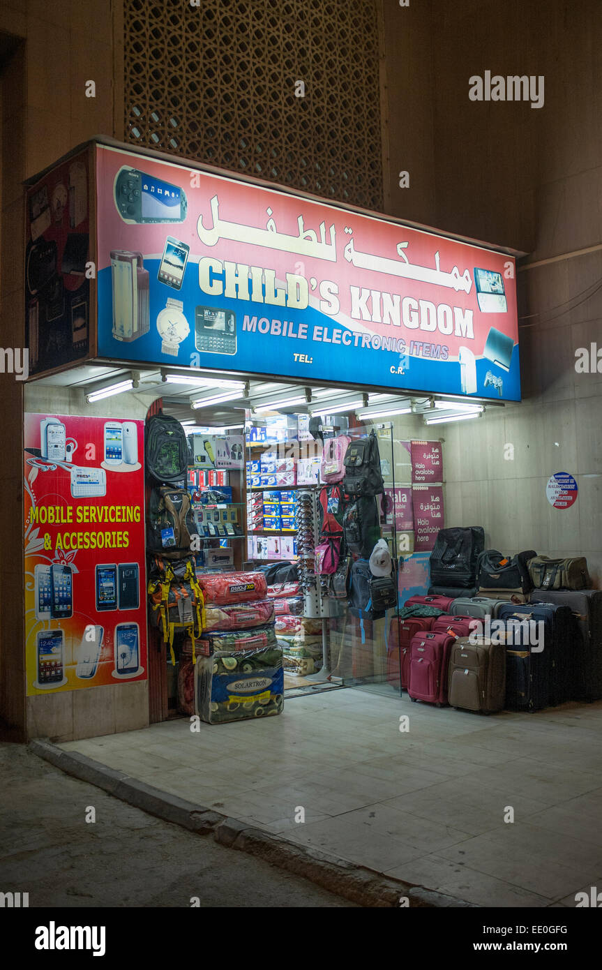 Electronics shop in Old Town Doha, Qatar at night - Stock Image