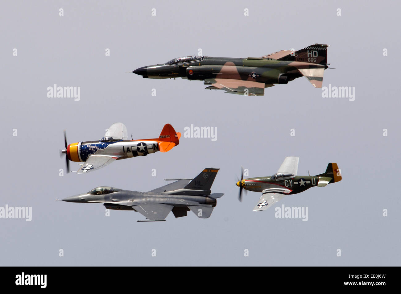 An F-4 Phantom, P-47 Thunderbolt, F-16 Fighting Falcon and P-51 Mustang fly in a heritage flight formation during - Stock Image