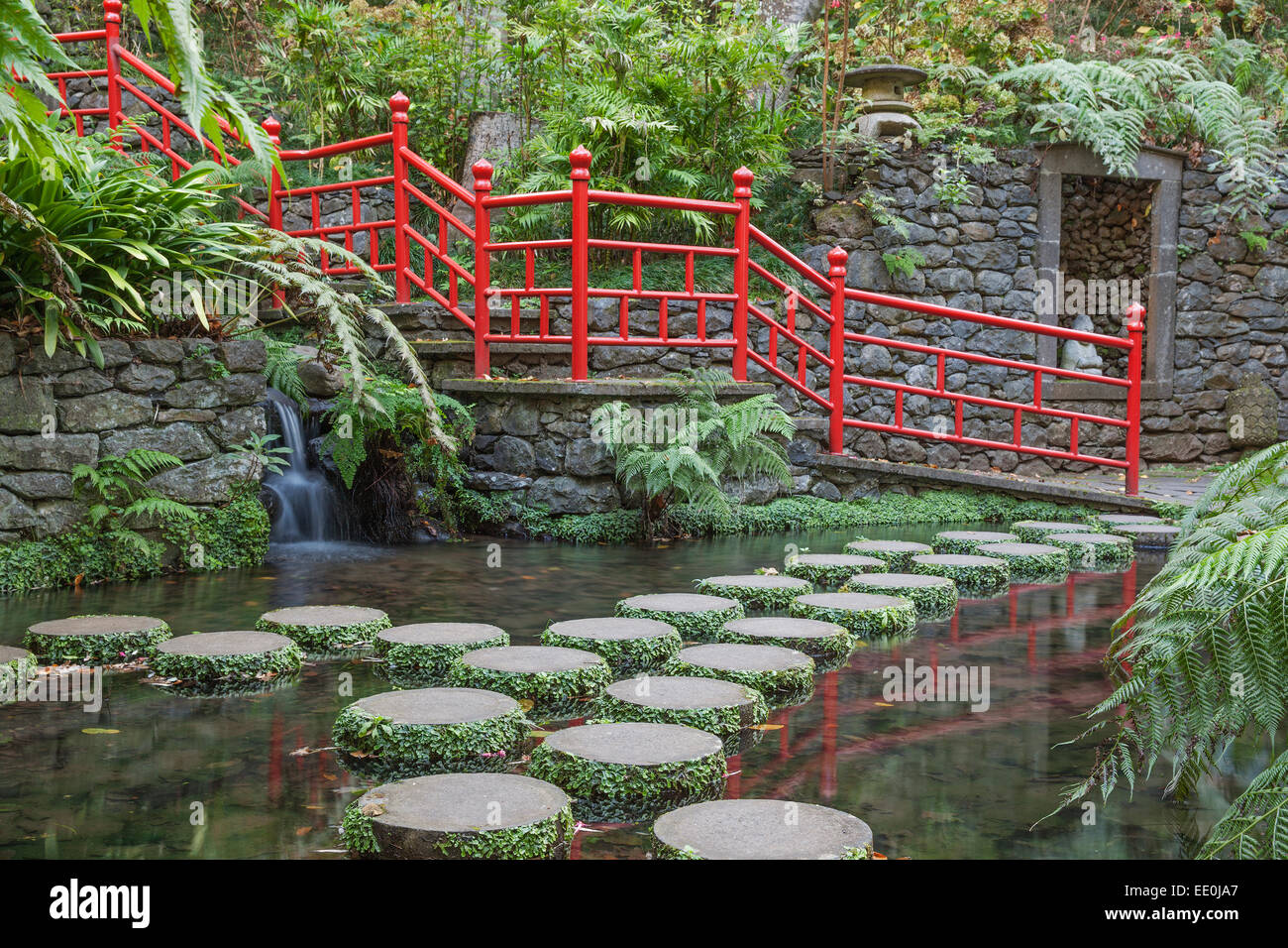 Stepping stones across oriental style lake - Monte Palace Gardens, Funchal - Stock Image