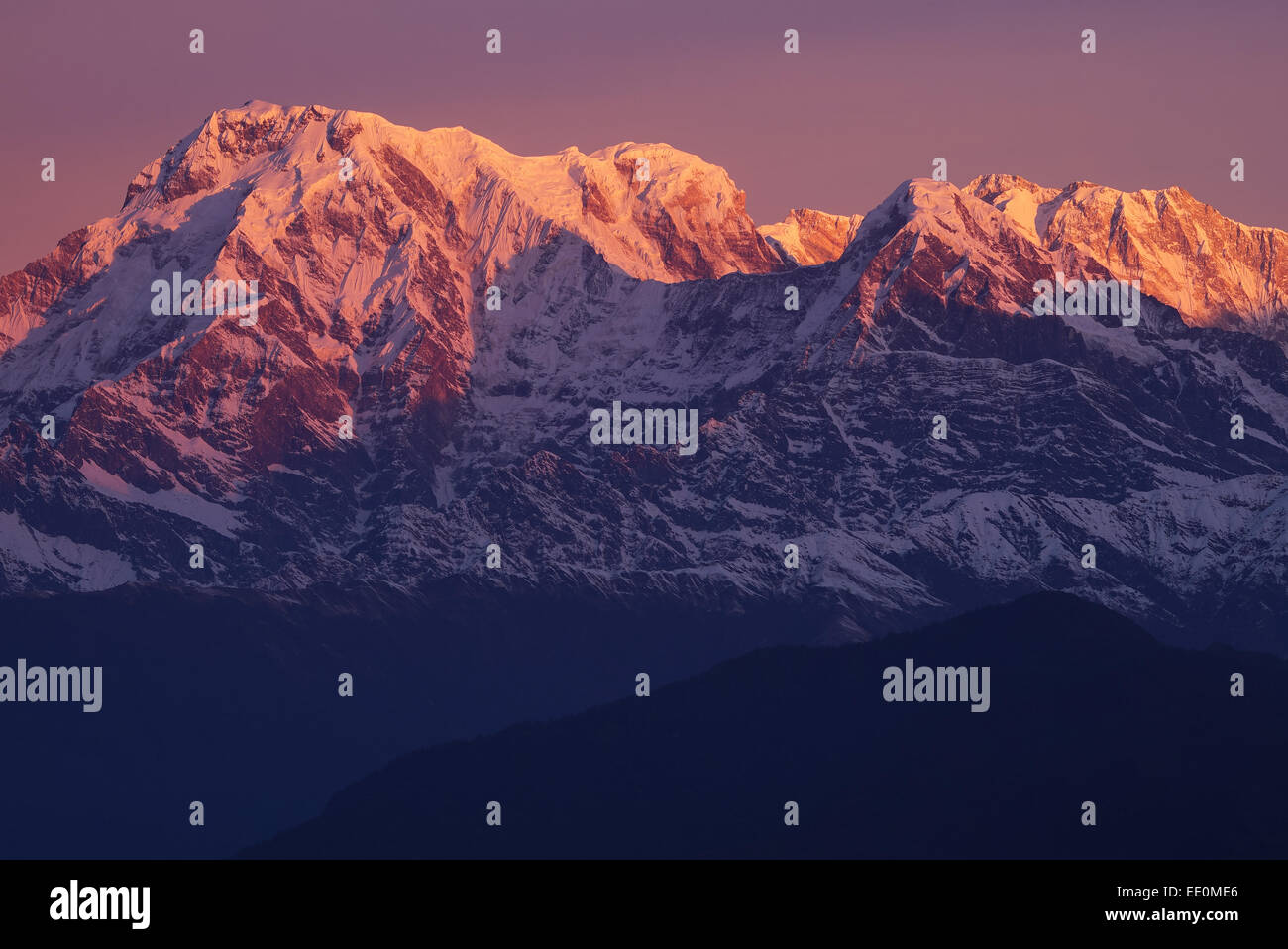 Sunrise over the Dhaulagiri massif of the Annapurna range in the Himalayas - Stock Image