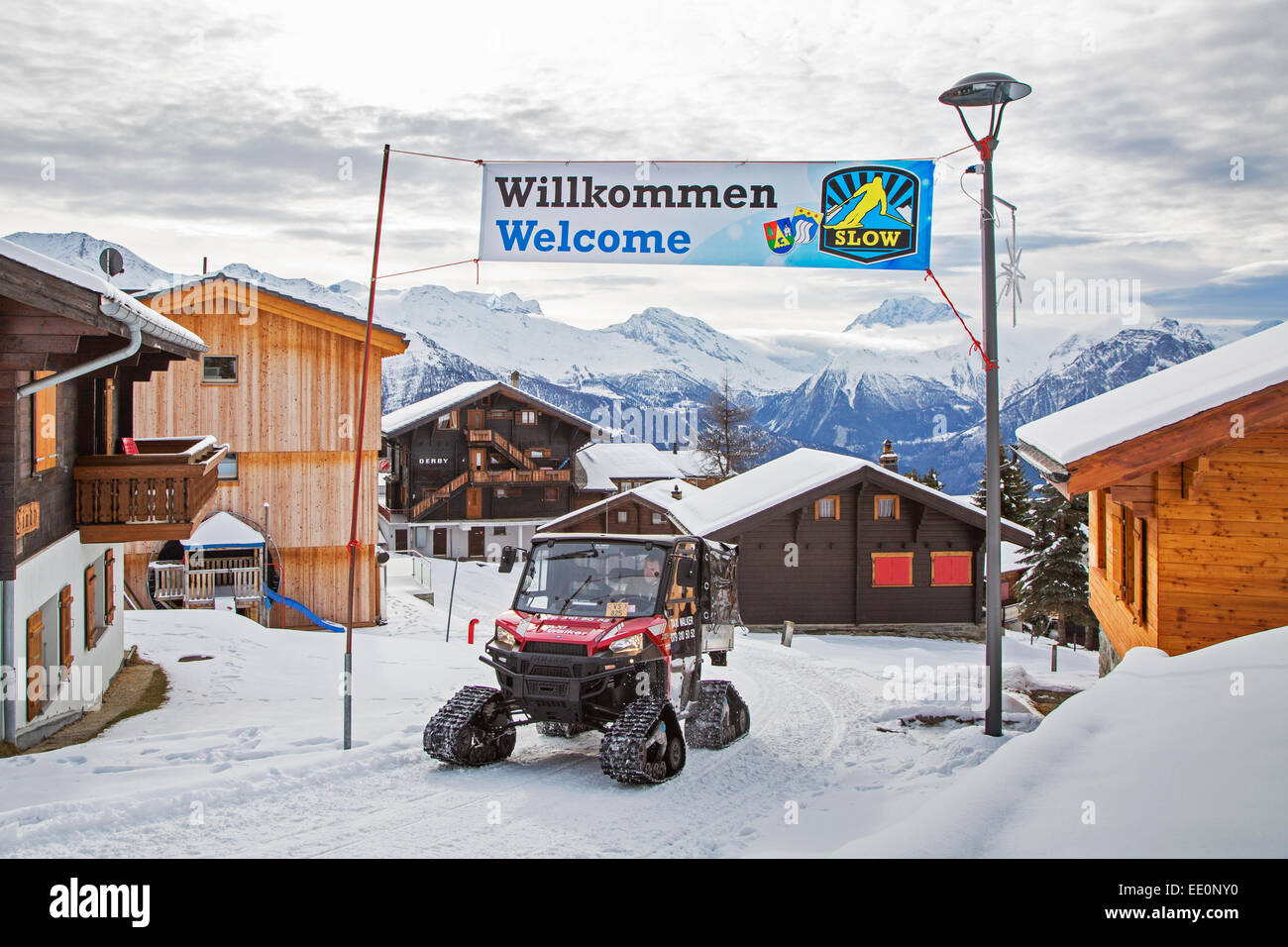 Polaris Taxi Walker XP fitted with rubber tracks driving through the Swiss traffic-free village Riederalp in the - Stock Image