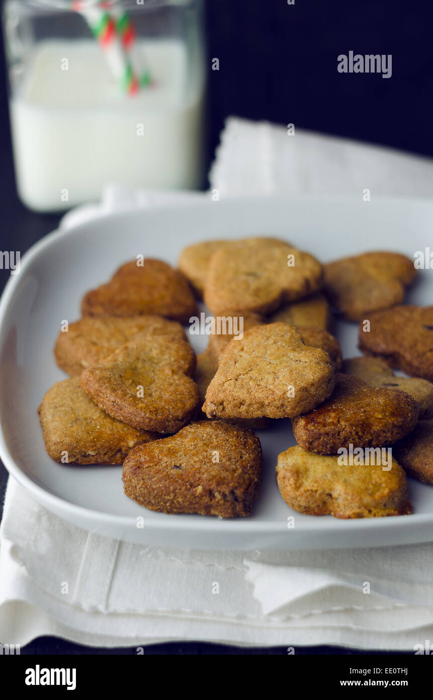 Homemade heart shaped cookies, over dark background - Stock Image