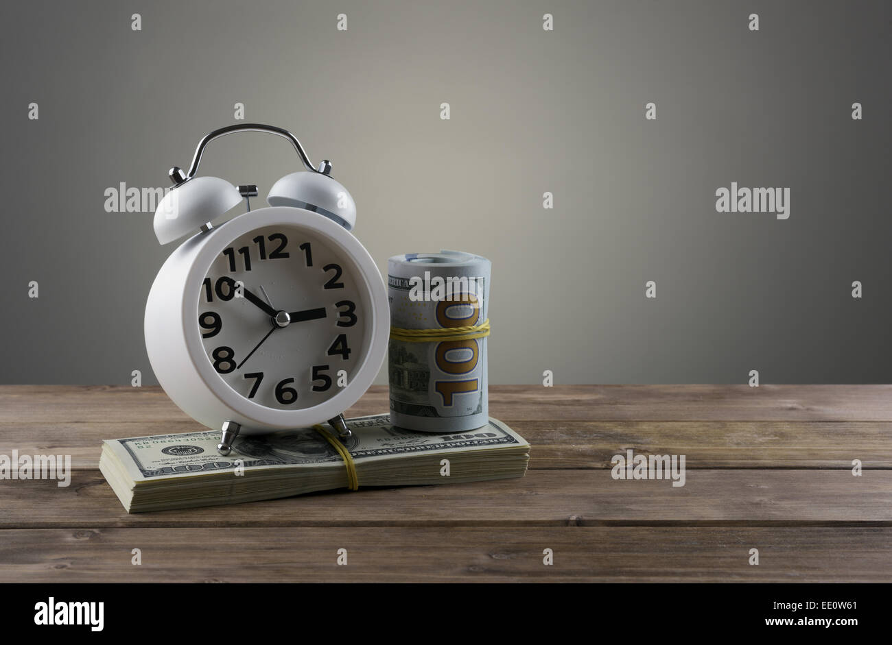 Time is money concept with clock and dollars - Stock Image
