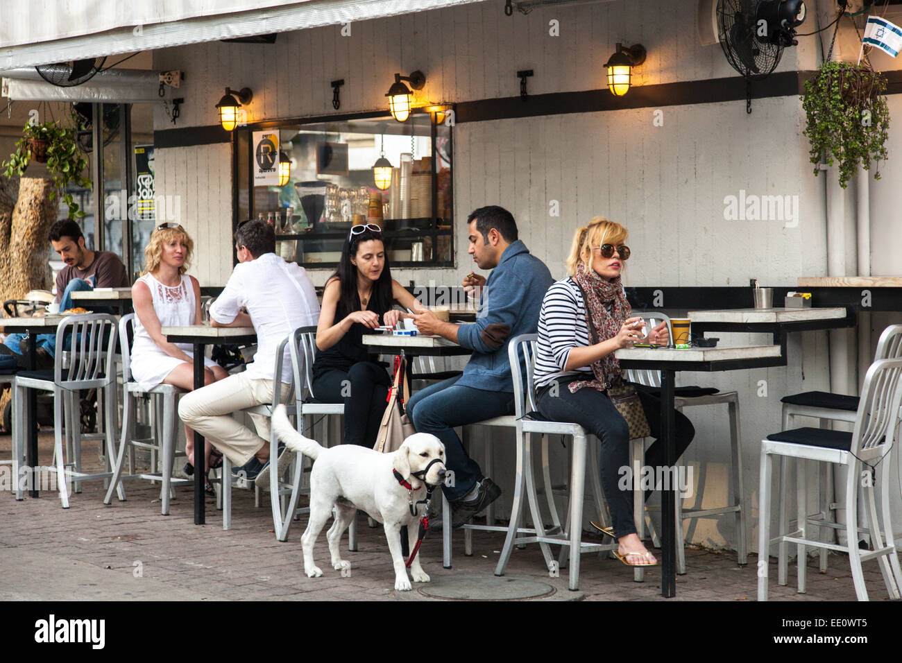 People sitting outside a cafe along Rothschild Boulevard in Tel Aviv, Israel - Stock Image