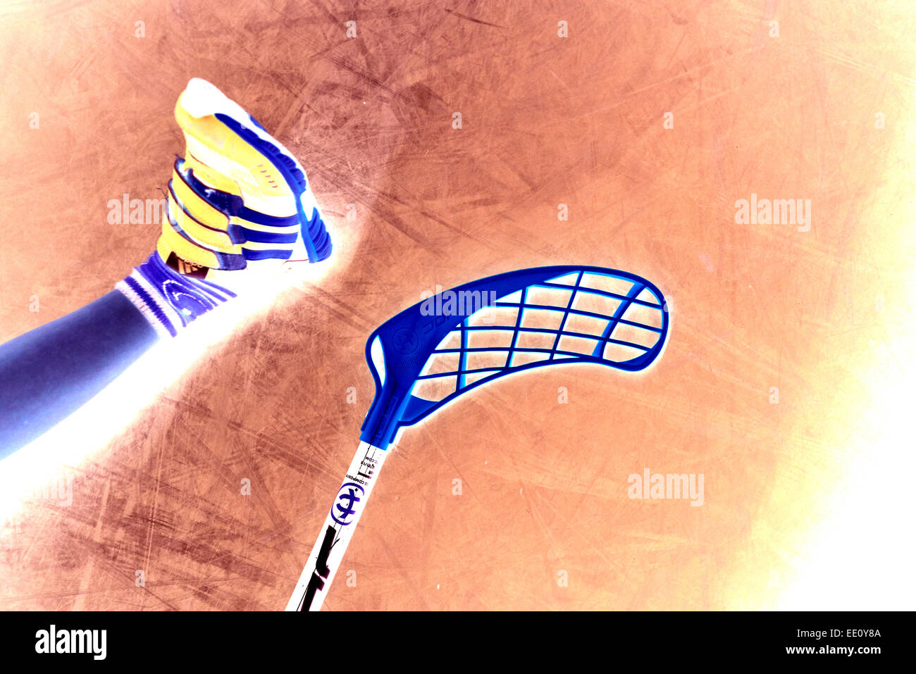 Children boys schoolchildren playing floorball (floor hockey) match in school gym hall with plastic hockey sticks - Stock Image