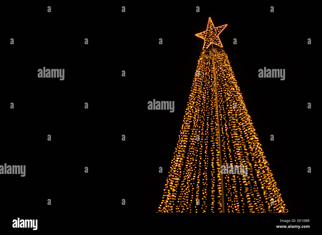 Christmas illumination in form of the top of a christmas tree - Stock Image