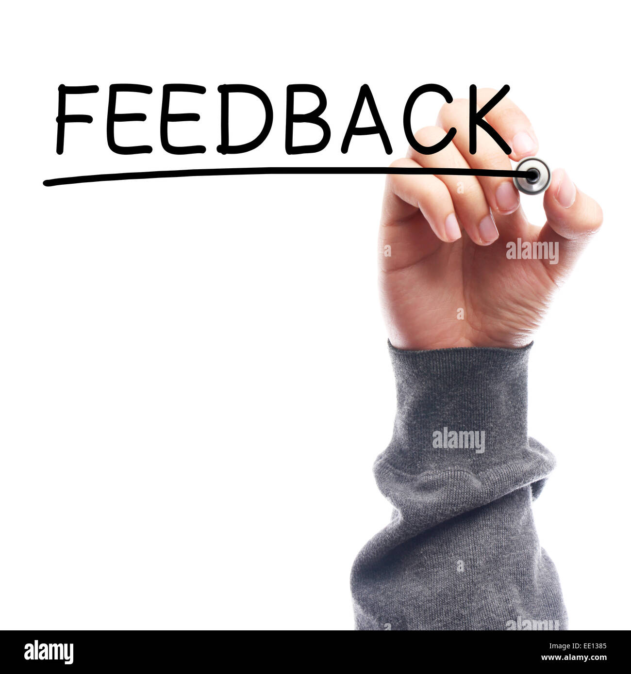 Hand with marker writing Feedback on transparent board against white background. Stock Photo