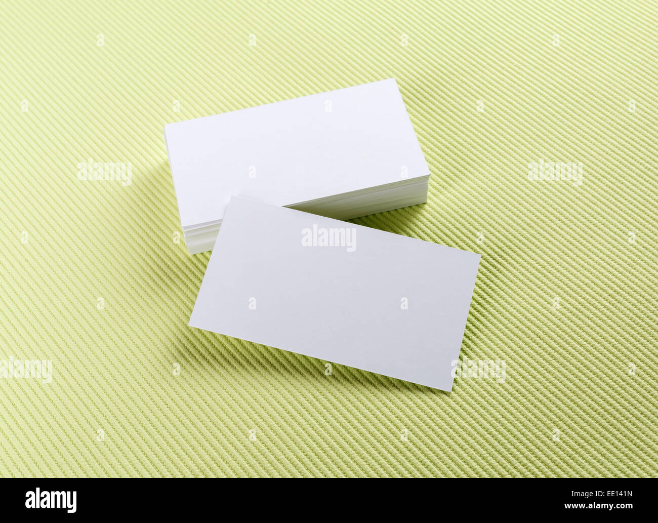 A stack of business cards on a green background. Template for Stock ...