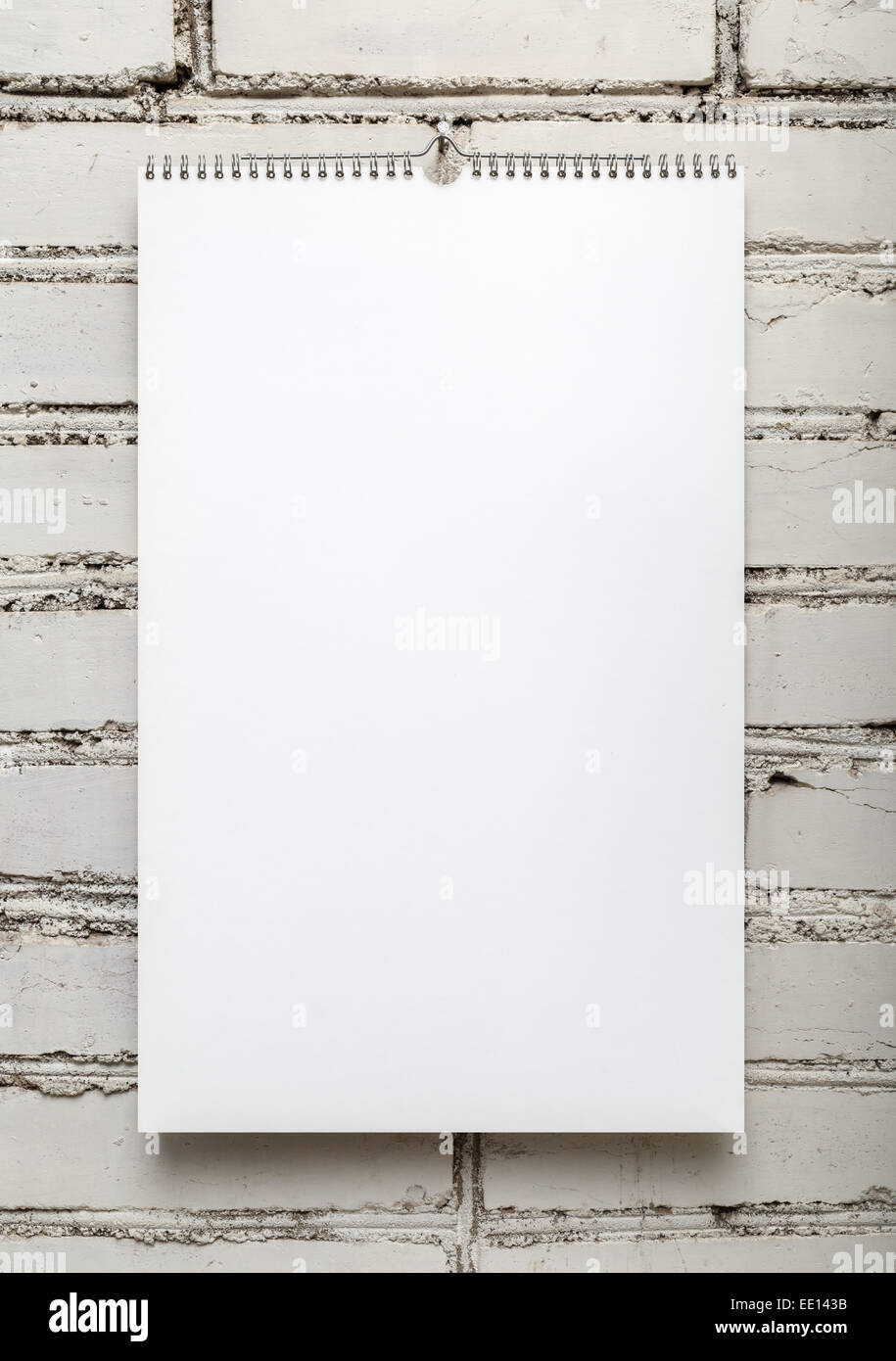 Blank album on a spring against a white brick wall. Template for ...