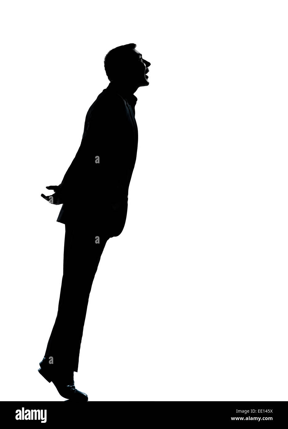 one caucasian business man silhouette standing tiptoe looking up Full length in studio isolated on white background - Stock Image