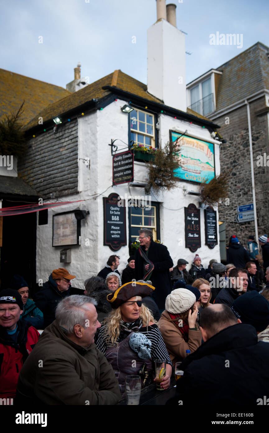 Drinkers outside the Sloop Inn, St. Ives, Cornwall,UK on New Years Eve 2014/2015 - Stock Image