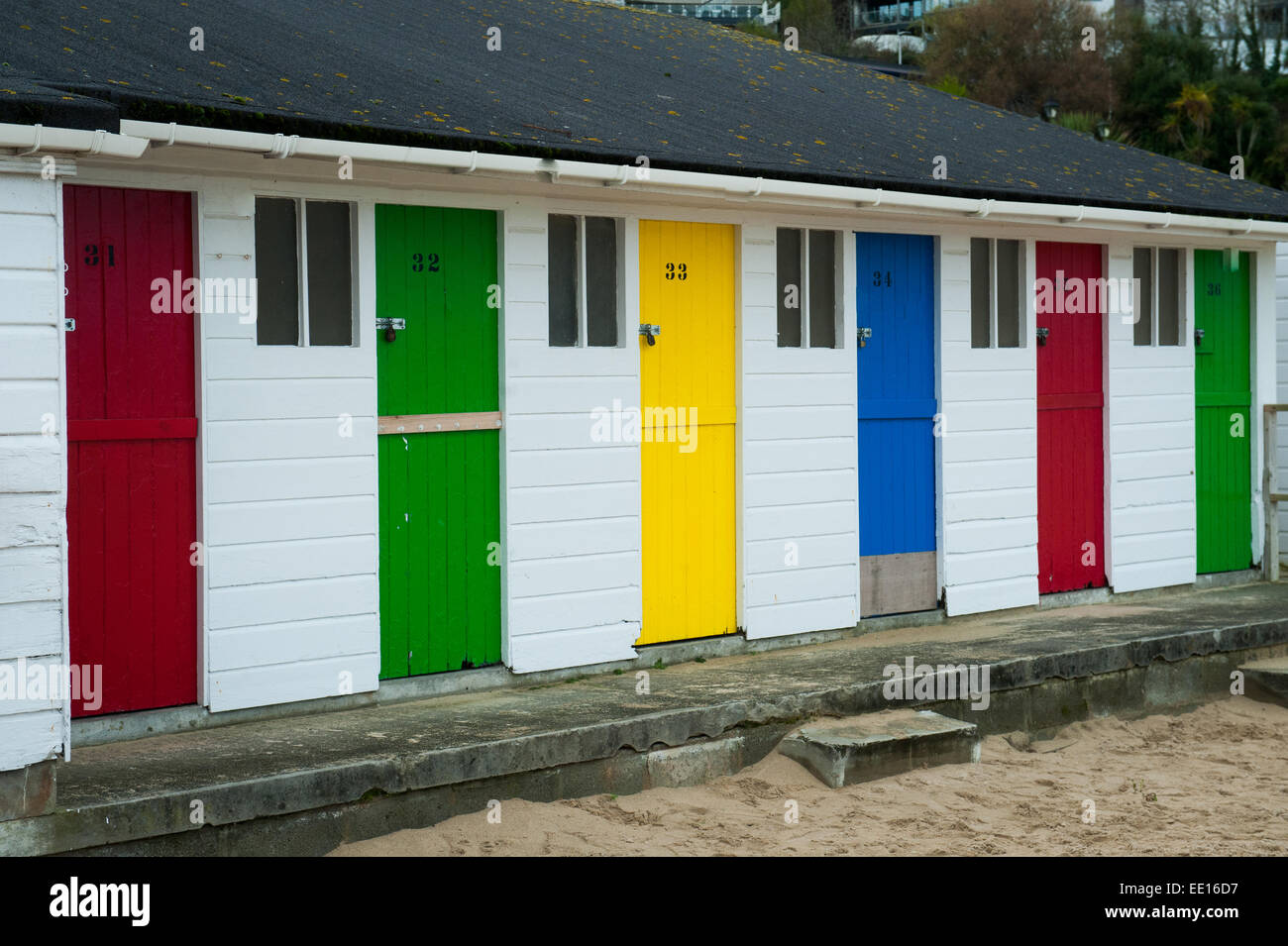 Brightly coloured beach huts on Porthminster Beach, St. Ives in Cornwall,UK Stock Photo