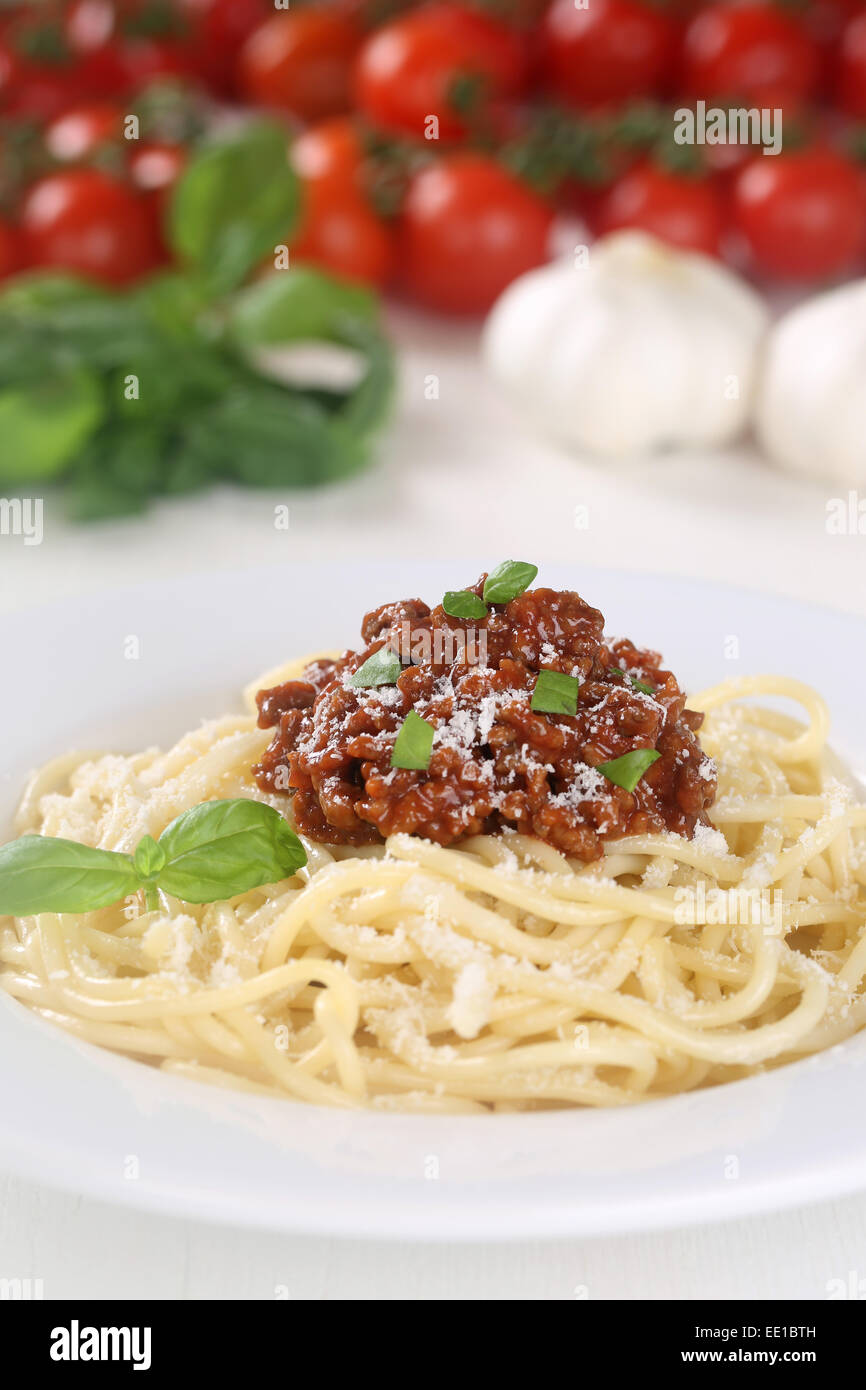Spaghetti Bolognese pasta meal with tomatoes and meat on a plate - Stock Image
