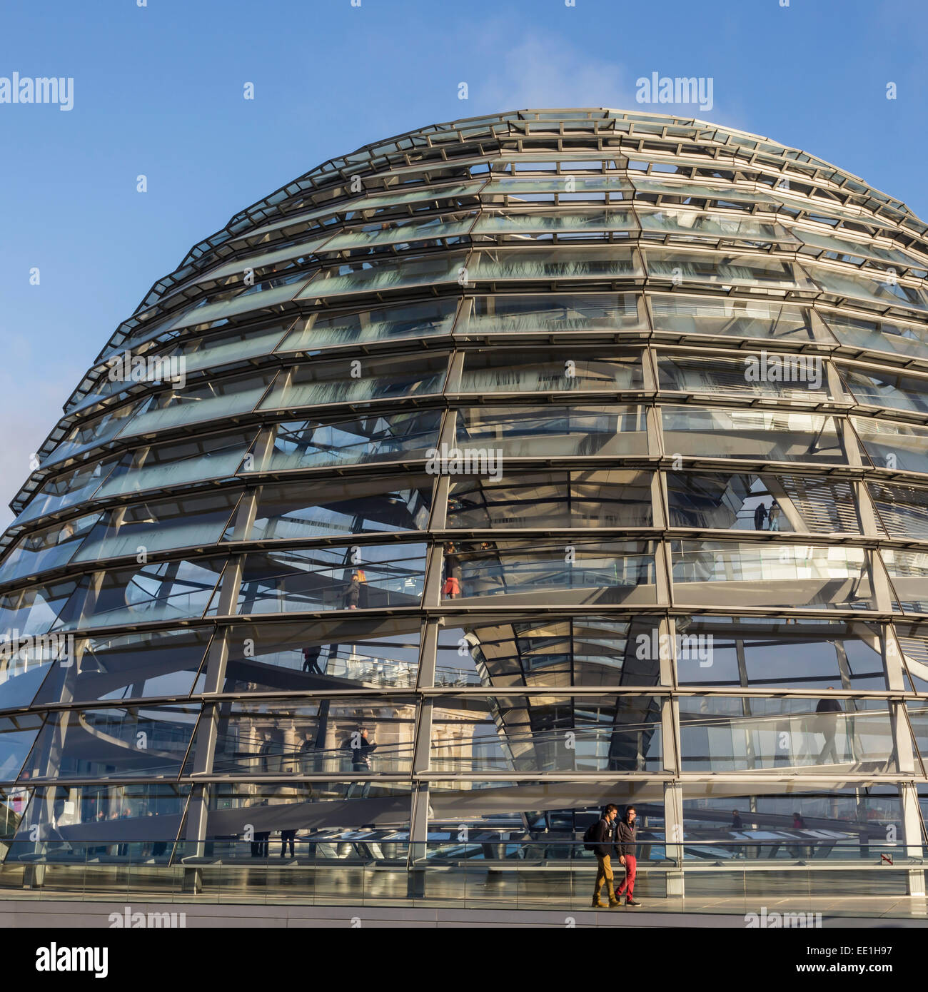 Reichstag dome exterior from its rooftop terrace, with passing visitors, early morning, Mitte, Berlin, Germany, - Stock Image