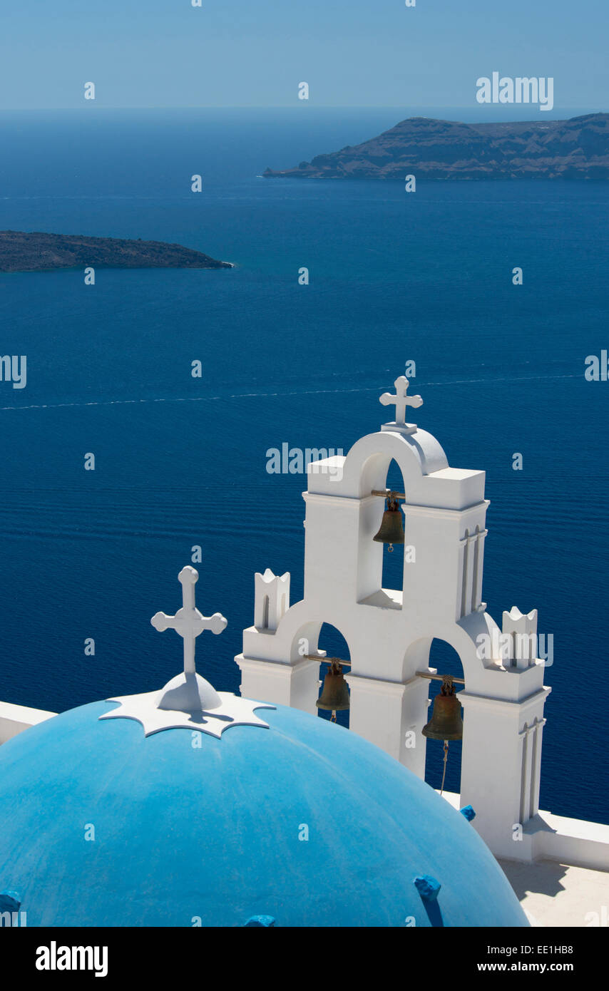 A blue domed Greek Orthodox church overlooking the sea in Firostefani, Santorini, The Cyclades, The Aegean, Greek - Stock Image