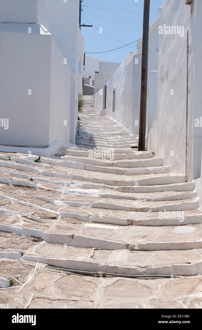 Stone steps up a path through the houses of Pano Petali in Sifnos, The Cyclades, Greek Islands, Greece, Europe - Stock Image