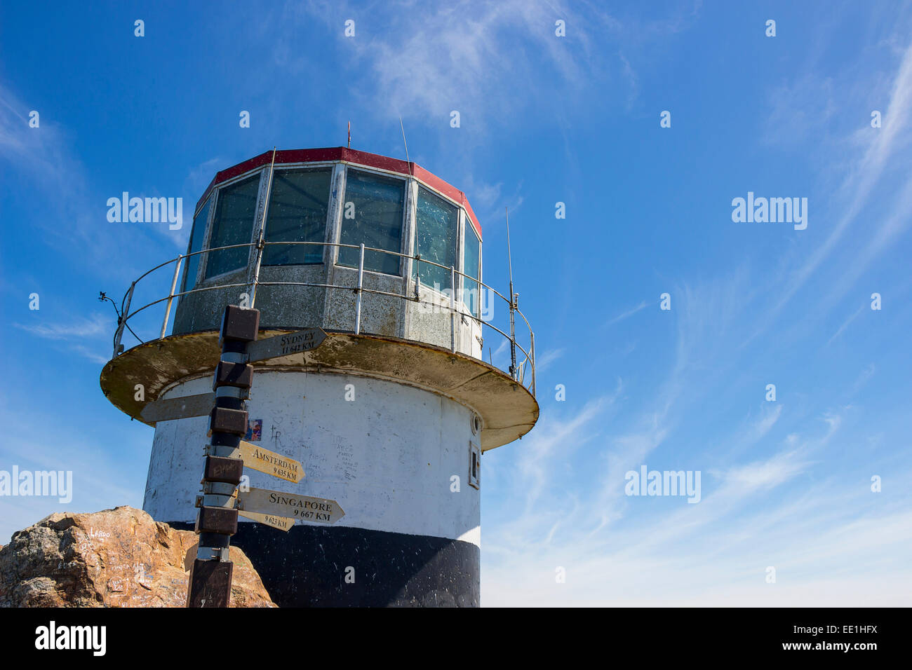 Cape Point Lighthouse on a partly cloudy day - Stock Image