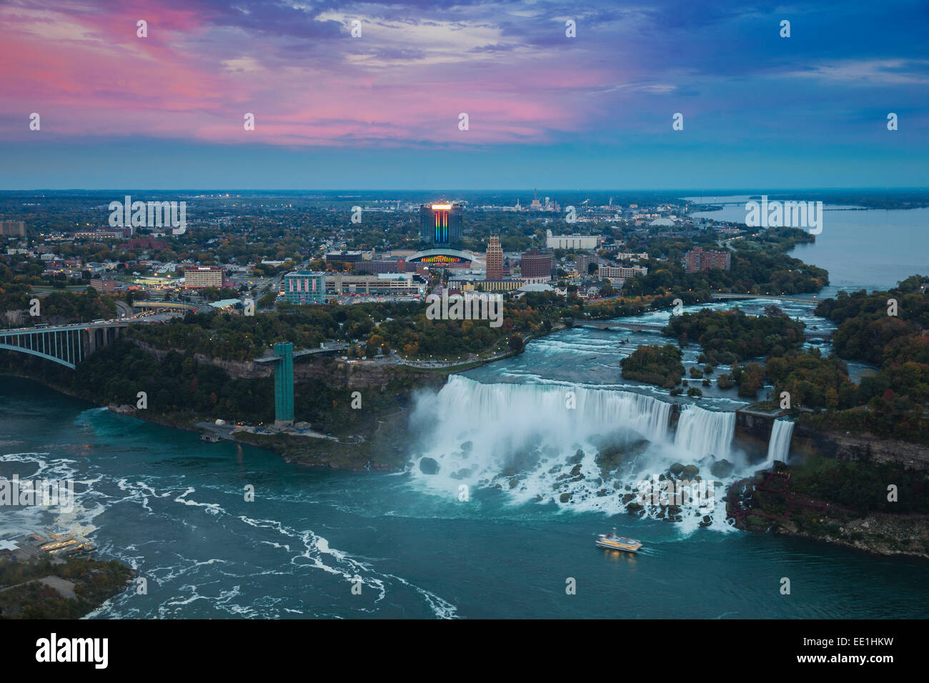 View of Rainbow Bridge and The American Falls, Niagara Falls, Niagara, border of New York State, and Ontario Canada - Stock Image