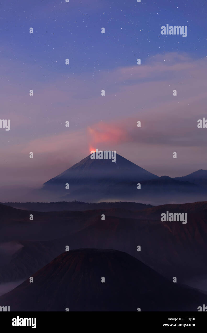 Active Gunung Bromo volcano at night, Bromo-Tengger-Semeru National Park, Java, Indonesia, Southeast Asia, Asia - Stock Image