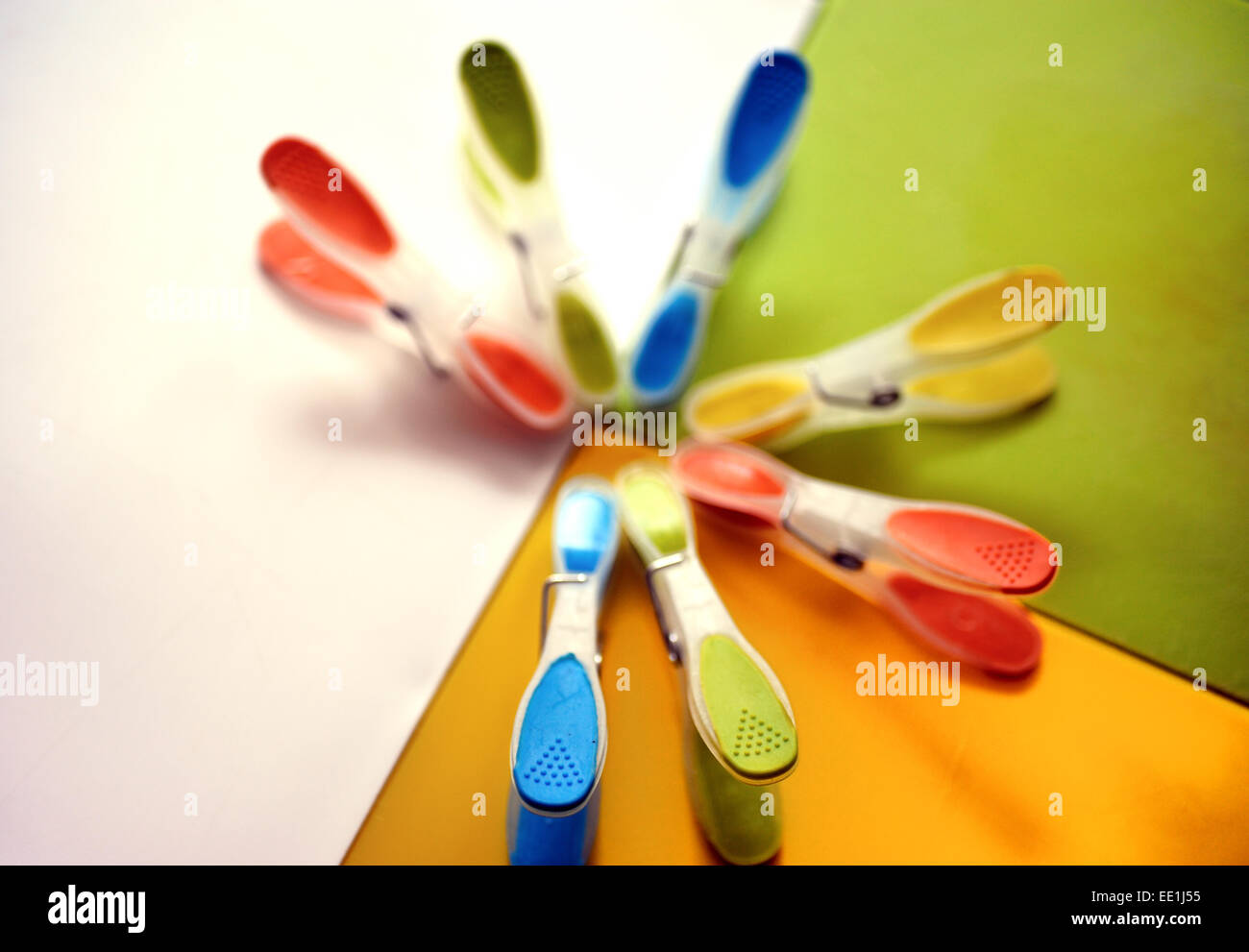 Clothes pegs arranged in an incomplete circle - Stock Image