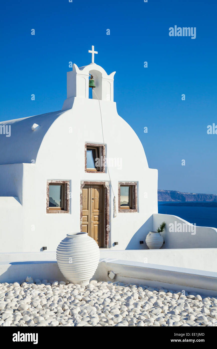 White church of Agios Vasilios overlooking Aegean Sea, Oia, Santorini (Thira), Cyclades Islands, Greek Islands, Stock Photo
