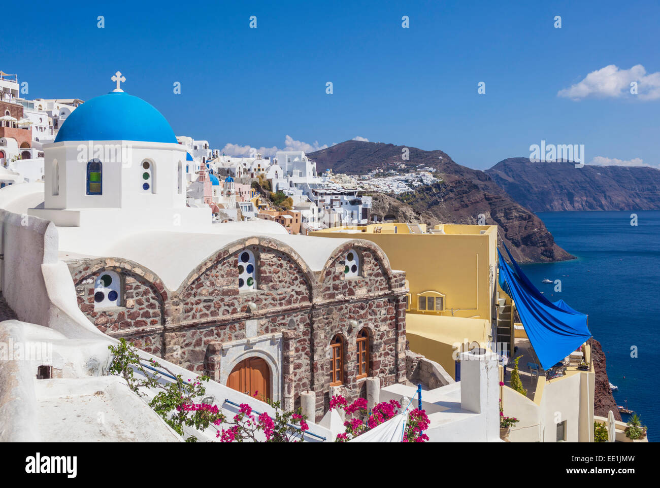 Greek church of St. Nicholas with blue dome, Oia, Santorini (Thira), Cyclades Islands, Greek Islands, Greece, Europe - Stock Image