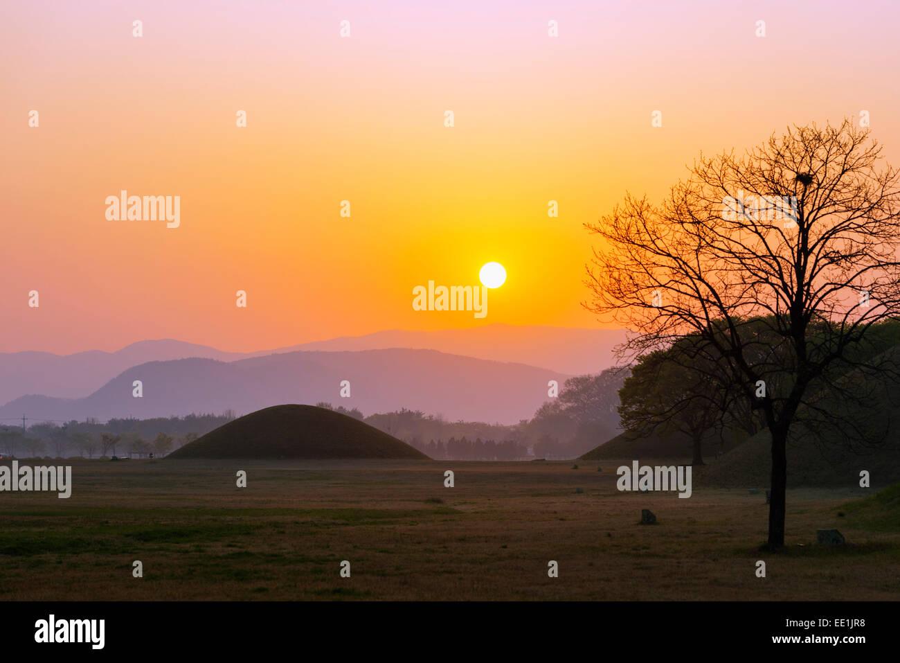 Royal Tombs burial mounds at sunrise, UNESCO World Heritage Site, Gyeongju, Gyeongsangbuk-do, South Korea, Asia - Stock Image