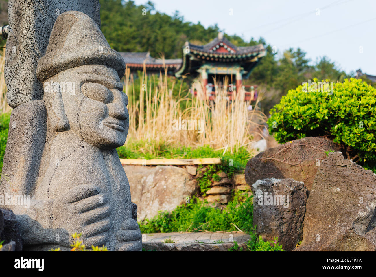 Dol hareubang (harubang) protection and fertility statue at Sanbanggulsa Temple, Jeju Island, South Korea, Asia - Stock Image