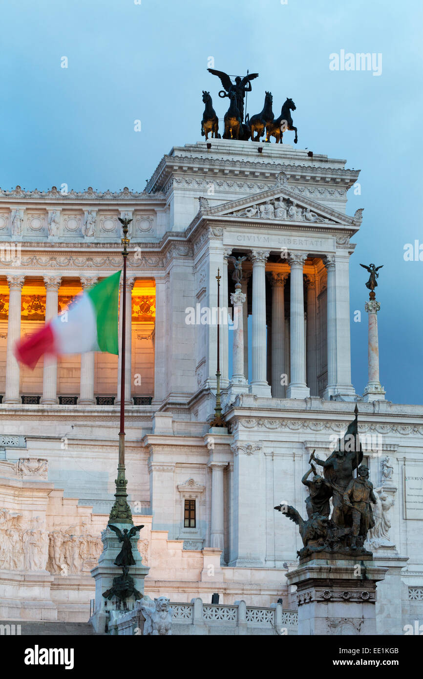 Italian flag in front of the Victor Emmanuel Monument at night, Rome, Lazio, Italy, Europe - Stock Image