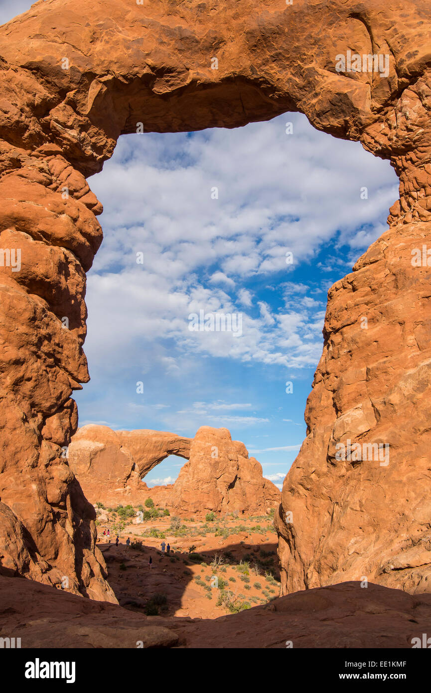 South Window Arch seen through Turret Arch, Arches National Park, Utah, United States of America, North America - Stock Image