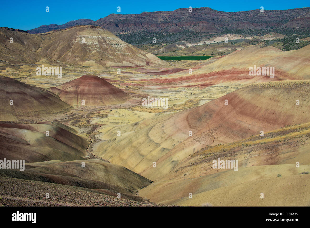 The colourful hills of the Painted Hills unit in the John Day Fossil Beds National Monument, Oregon, United States - Stock Image