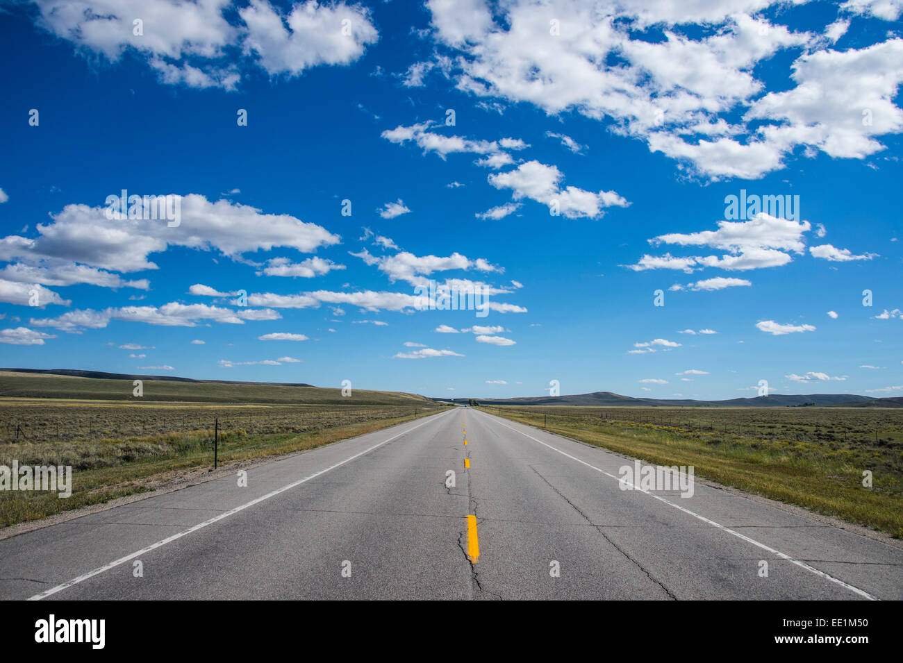 Long straight road in southern Wyoming, United States of America, North America - Stock Image