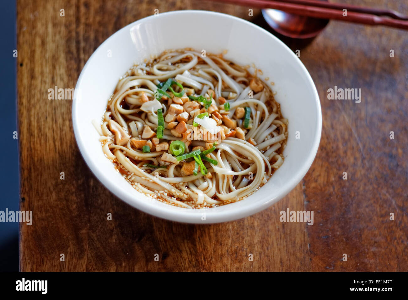 Noodles with tofu and spring onion - Stock Image