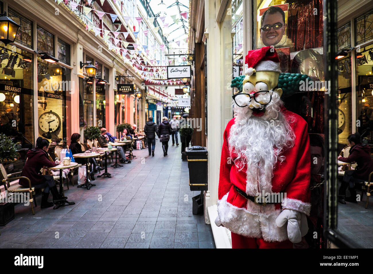 A scary looking Father Christmas outside a shop in Castle Arcade in Cardiff. - Stock Image