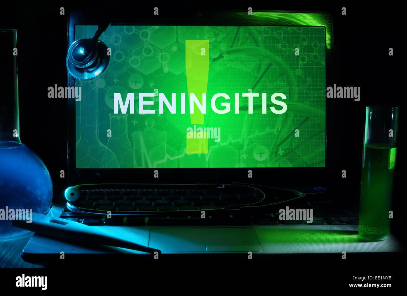 Notebook with words  meningitis , test tubes and stethoscope - Stock Image
