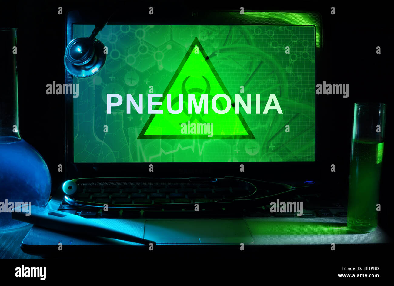 Notebook with words  Pneumonia, test tubes and stethoscope - Stock Image