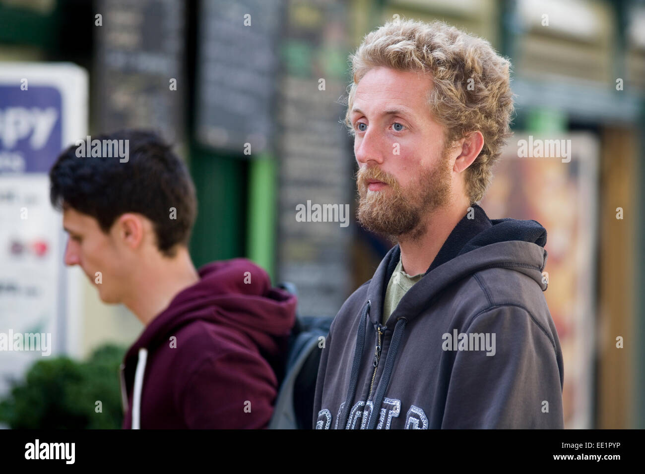 A young bearded male at St. Nicholas Market, Bristol. - Stock Image