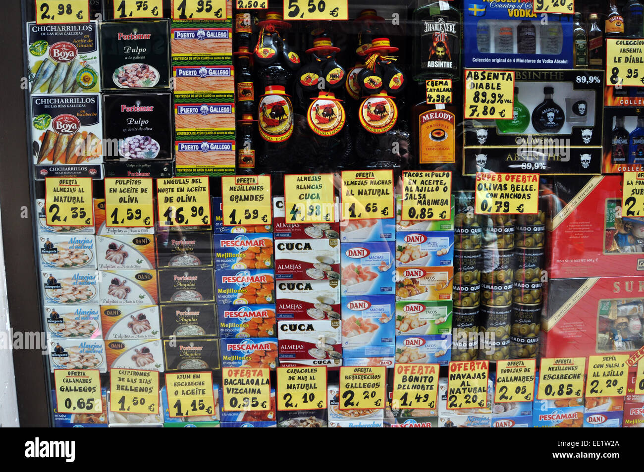 Tins of food and prices are displayed in a local shop window, Barcelona, Spain - Stock Image