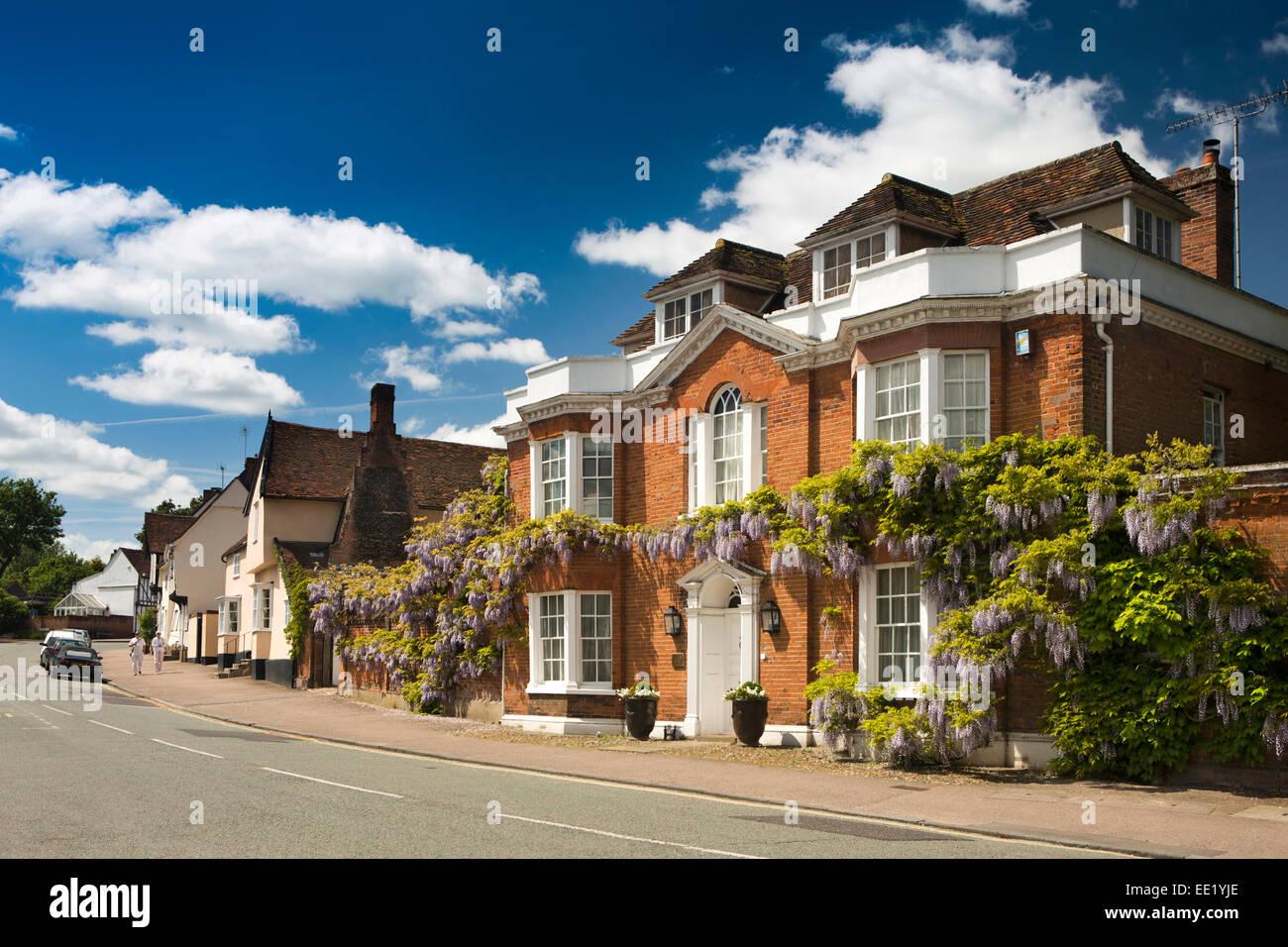 UK England, Suffolk, Lavenham, Church Street, wisteria clad Regency House - Stock Image