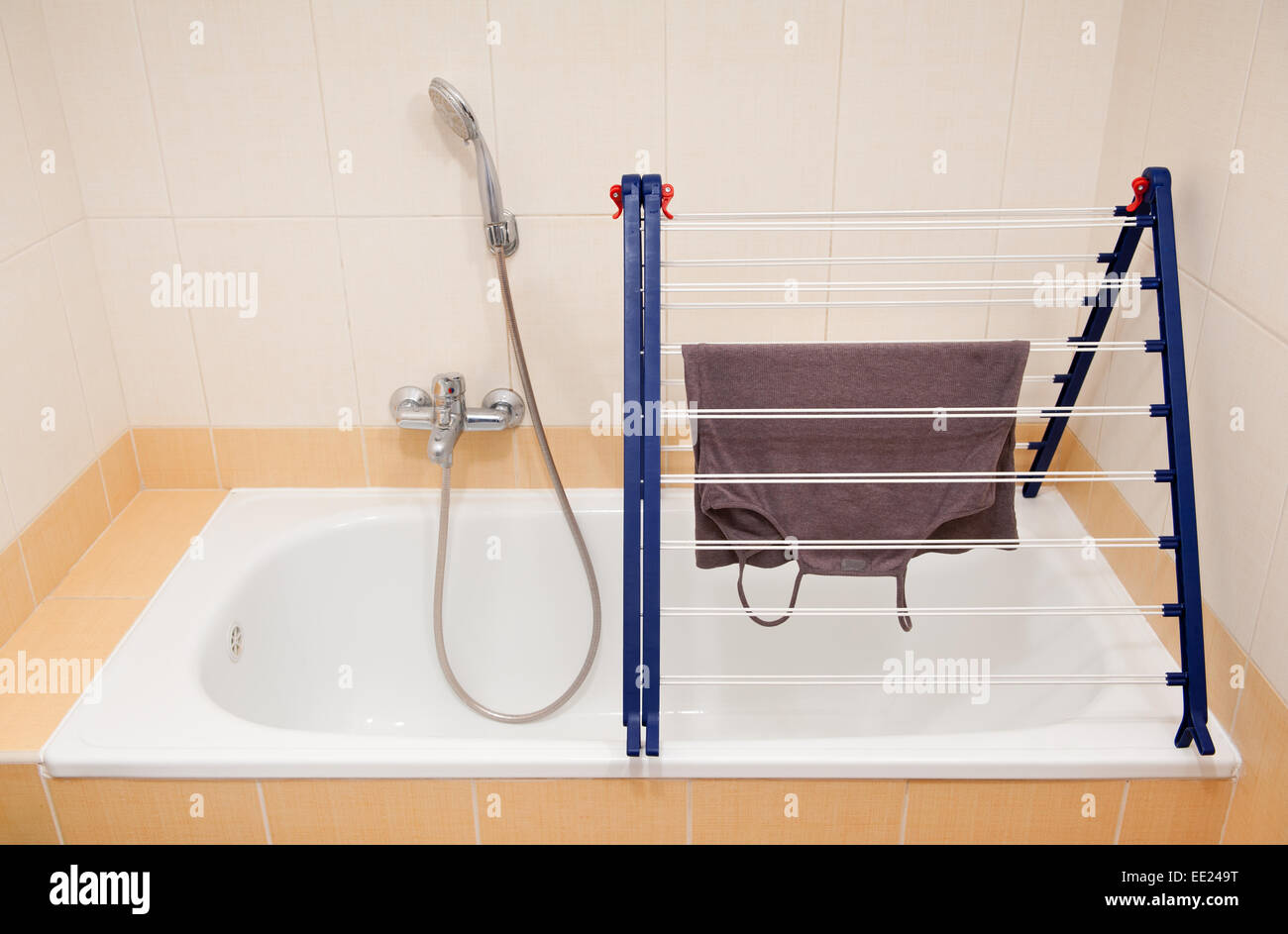 Foldable clothes horse drying rack over bath Stock Photo: 77493972 ...
