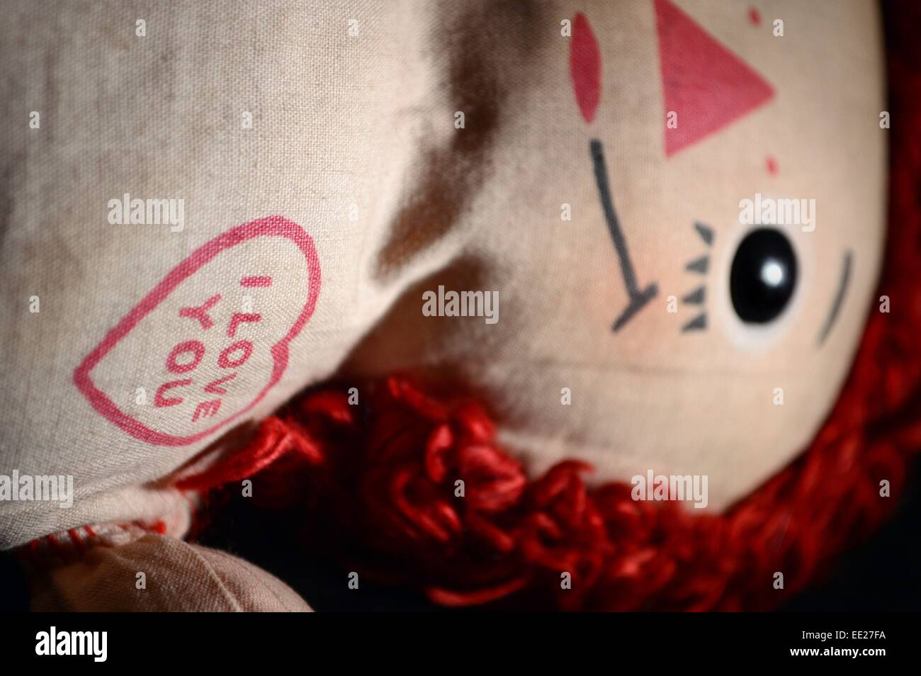I Love You, close up focus on heart with the words saying I love you on a raggedy ann doll,doll face is out of focus - Stock Image