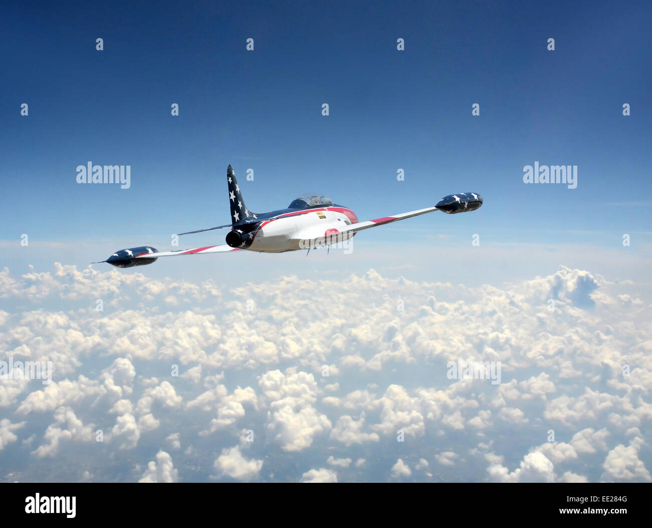 Jetfighter in US flag colors above the clouds T-33 Shooting Star - Stock Image