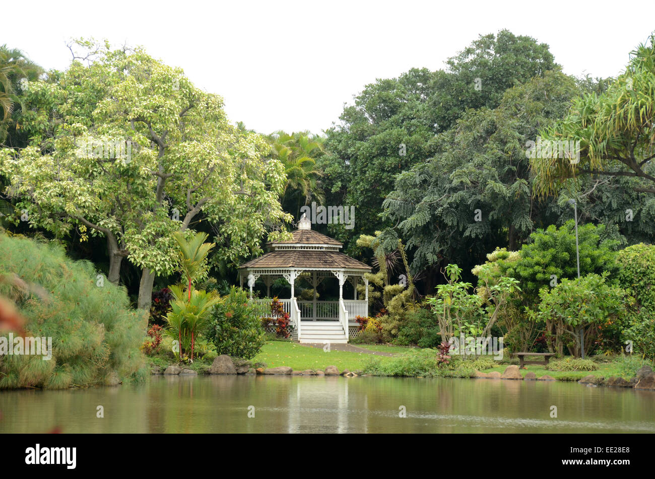 Gazebo on a lush tropical lake - Stock Image