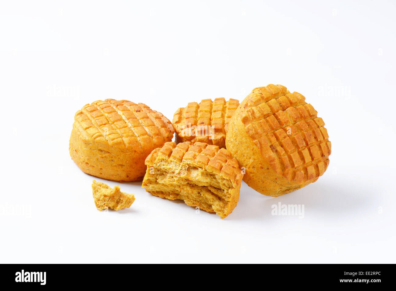 Small spiced savory biscuits on white background - Stock Image