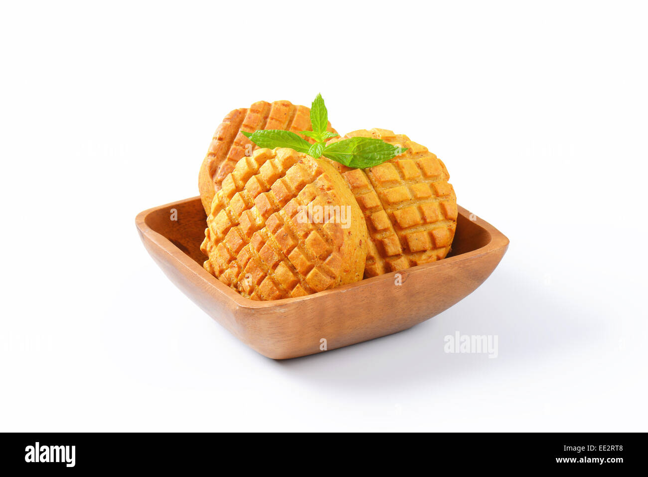 Small savory biscuits in square wooden bowl - Stock Image