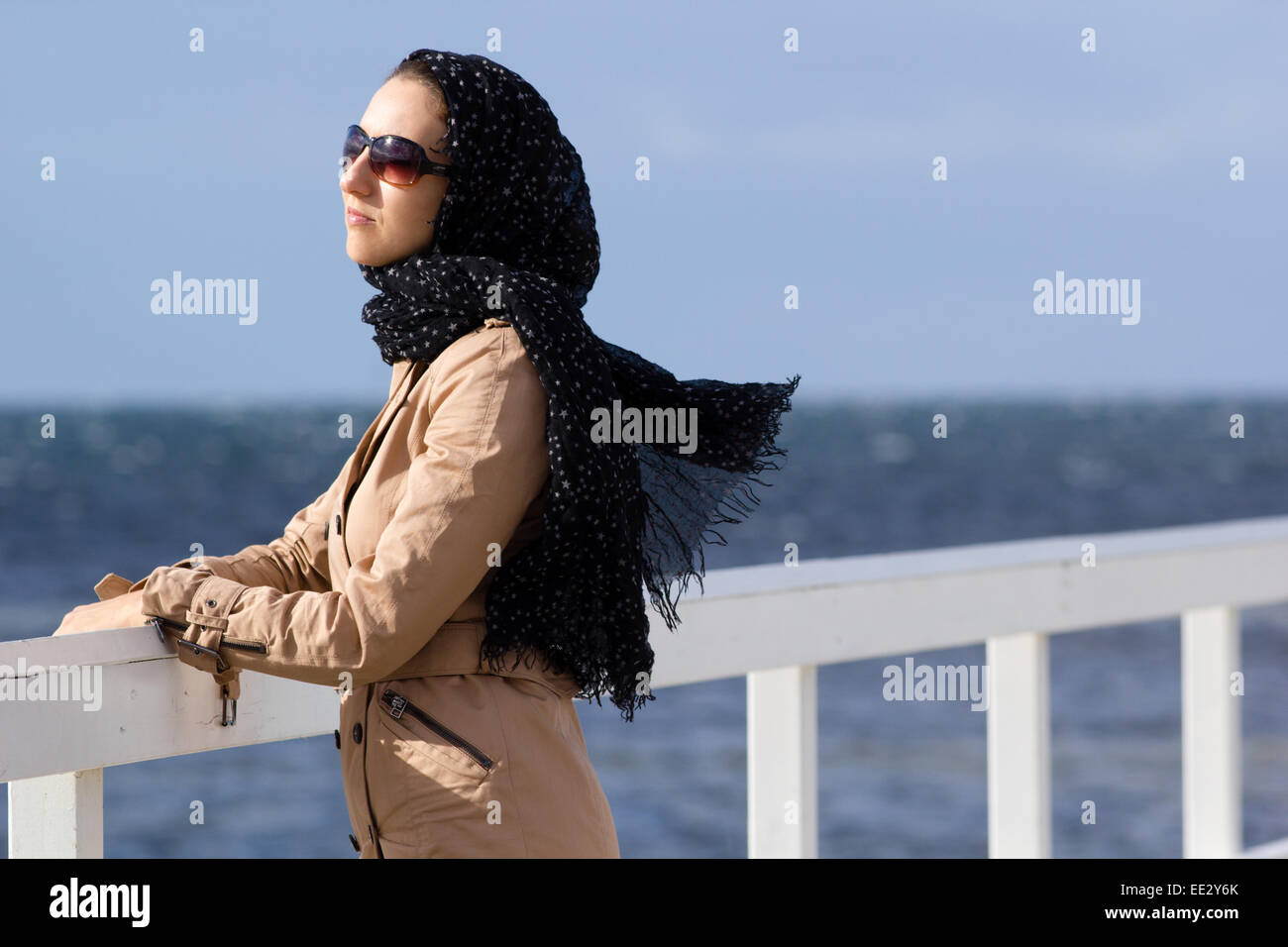 A woman on a pier in Malmo in Sweden. - Stock Image
