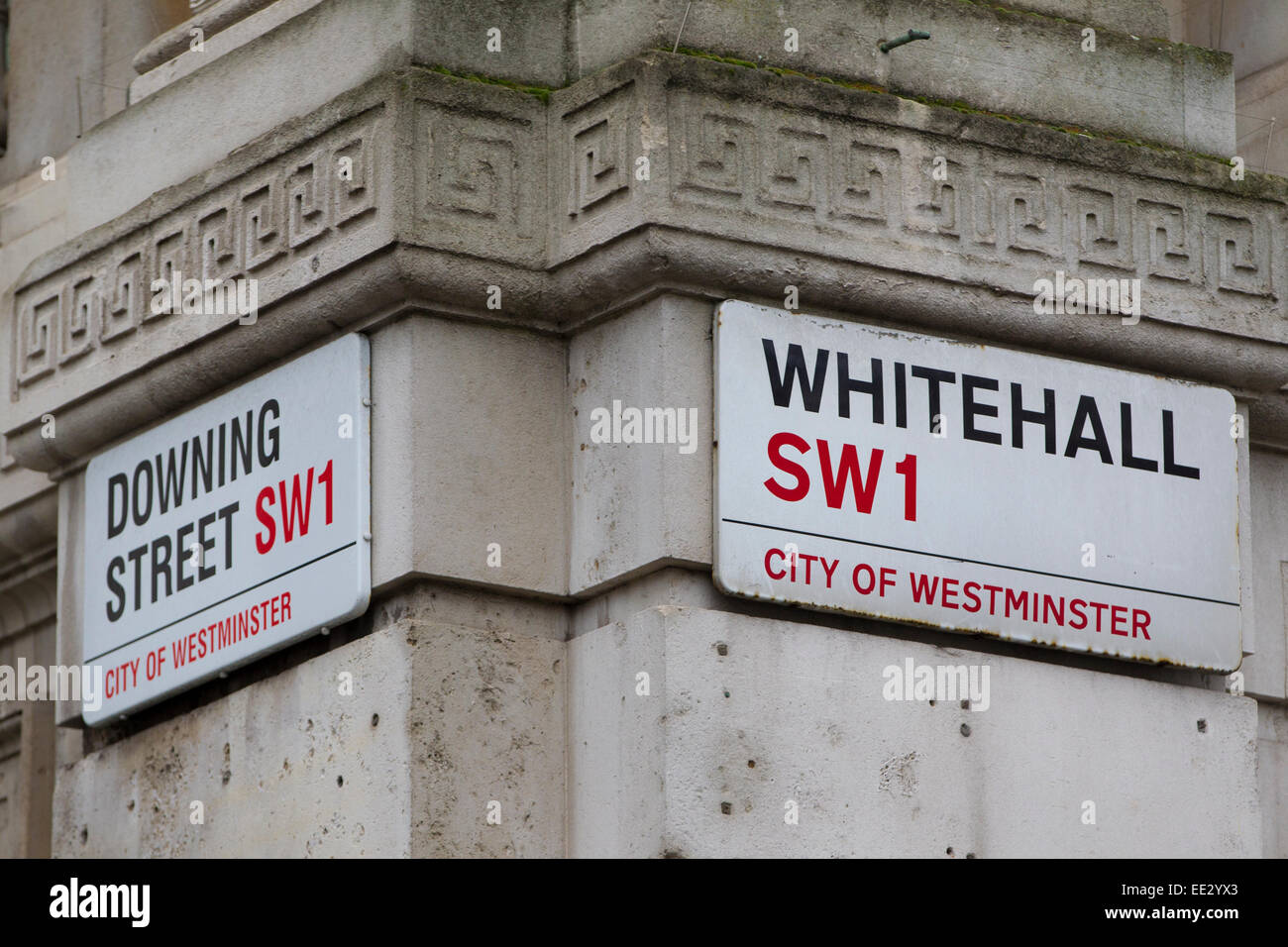 Downing Street and Whitehall signs on adjacent streets in Westminster, Central London, England, UK - Stock Image