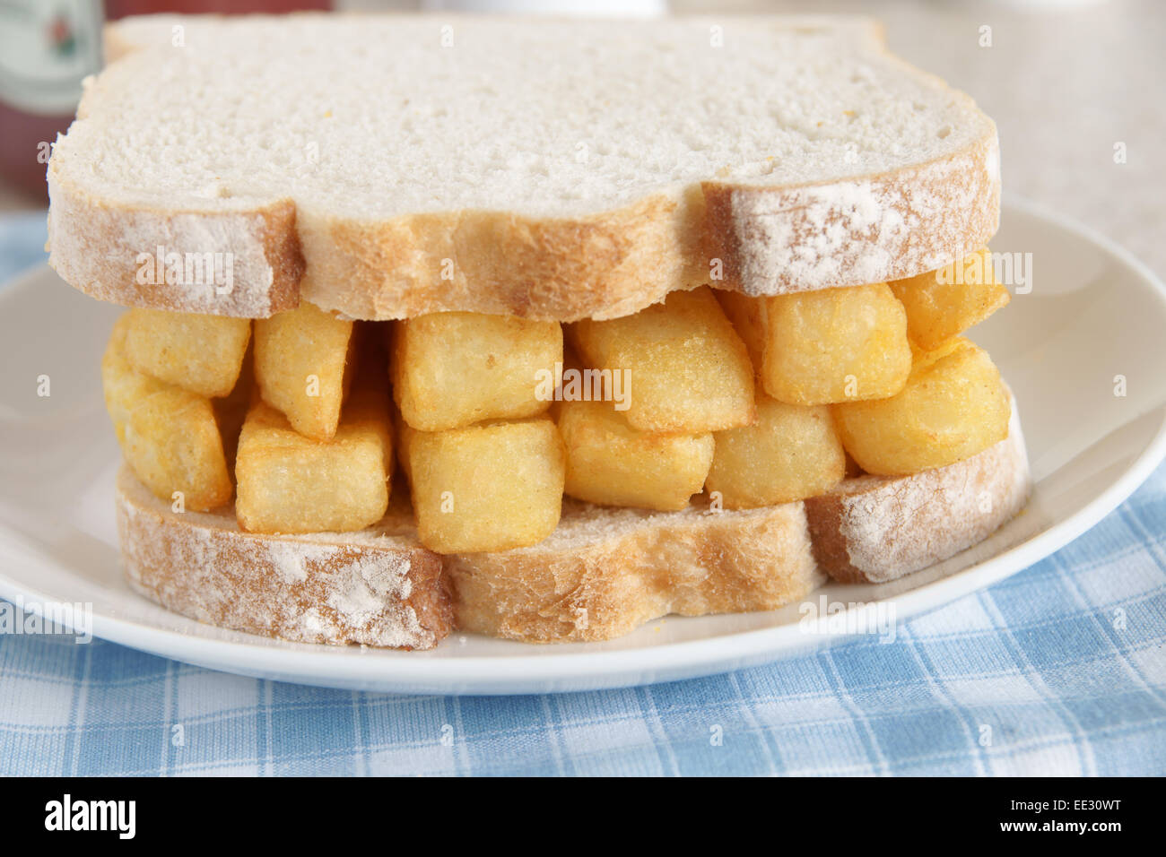 Chip Butty potato chips or fries in a sandwich - Stock Image