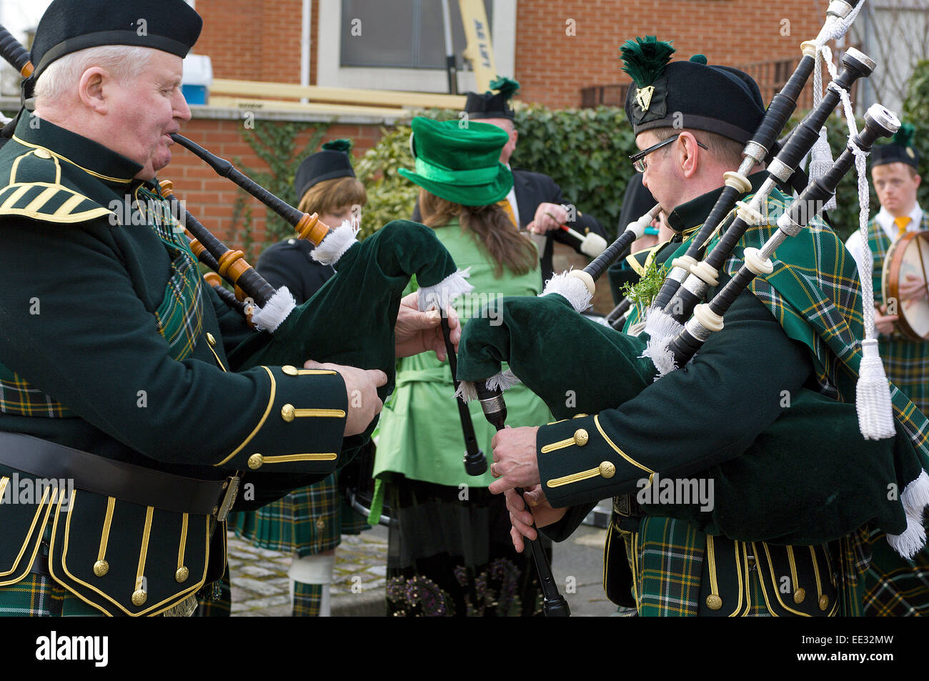 Irish pipers warm up on their bagpipes before the St. Patrick's Day parade in Willesden Green. - Stock Image